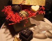 gift boxed set of four delicious chocolate - cand....wait for it....CANDLES..in a decorative box
