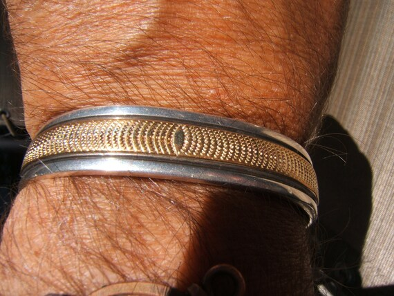 Navajo sterlin/gold cuff, signed Mark Yazzie.......unisex bracelet 5- 1/2 inch ....classic, iconic, dramatic