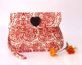 Orange clutch pleated purse, orange and white floral purse