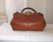 Vintage French old leather doctor bag.