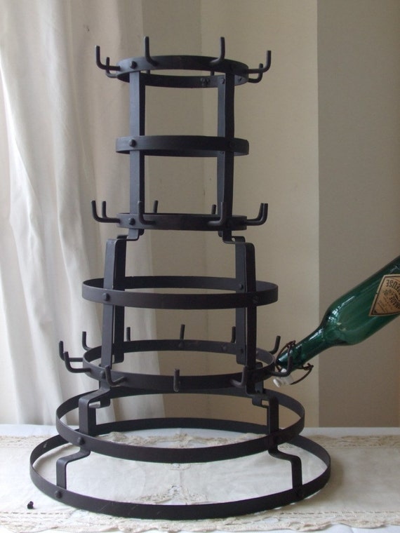 Vintage French bottle drying rack.  Country cottage chic