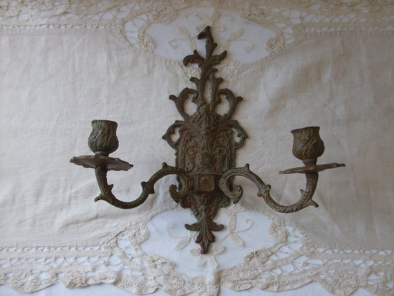 A lovely old vintage French cast iron double wall hanging candelabra