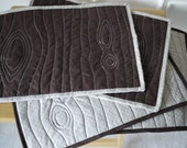 """Eco friendly quilted placemats with stitched """"faux bois' design - various colours, made from recycled fabric"""