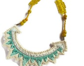 Embroidered geometric abstract triangle pendant in beautiful mint greens with yellow glass beads modern jewelry