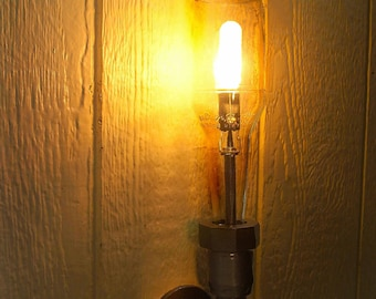 Wall Light. Lamp. Beer bottle, Plumbing pipe & fittings. Wall light. Lighting Fixture. Sconce