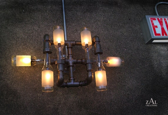 Wall  Light. Lamp. Beer bottles. Plumbing pipe & fittings. Wall light. Lighting Fixture.