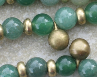 Mala style necklace in aventurine & brass with tiny bells