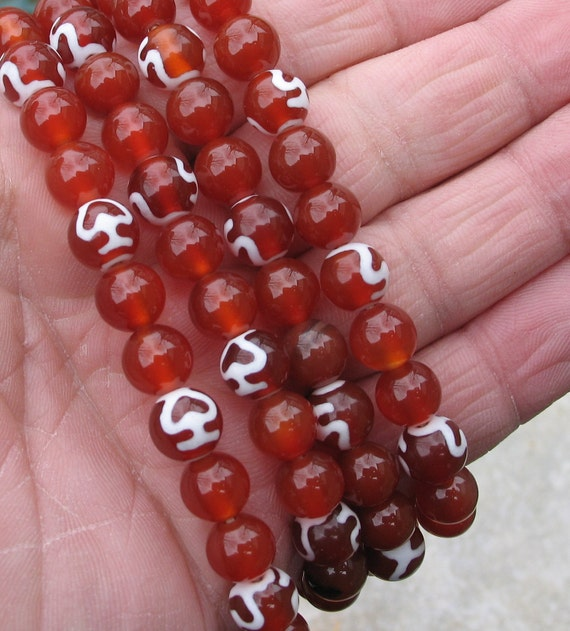 108 Buddhist prayer mala in AAA carnelian with tiny bodhi dzi beads