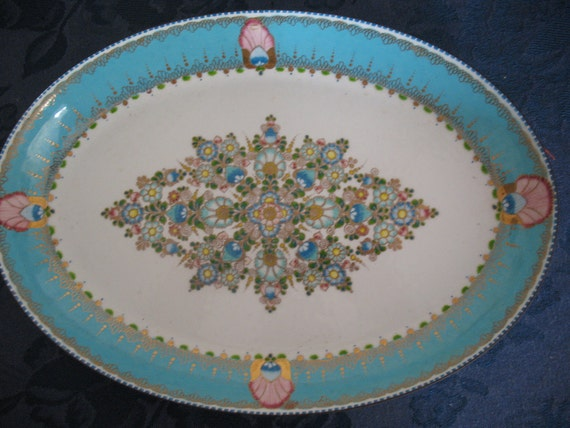 enameled serving dish in turquoise and gold handmade by steinboeck austria