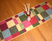 Table Runner in rich tones of red, gold and green