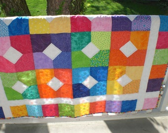 Custom made baby quilt in your choice of colors.