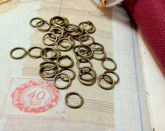 10 mm Antiqued Bronze Jump Rings (.mmagh)