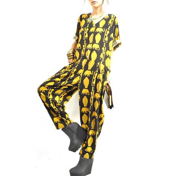 80s AFRiCAN JUMPSUiT / oversize slouchy fit / iconic gold symbols / dramatic harem leg / black / breezy rayon