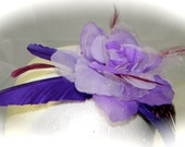 Purple, lilac and violet feather and flower fascinator
