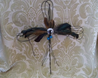Wire cross with feathers