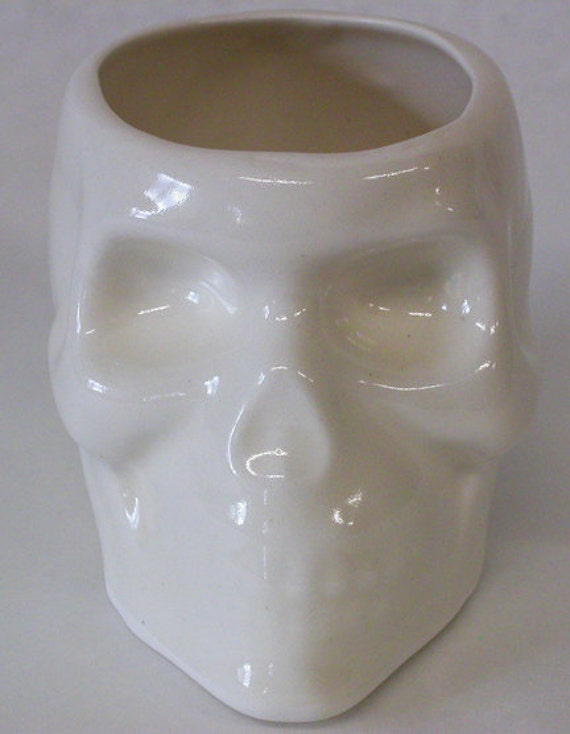 A set of Two Skull Cups or Small Planters