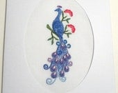Embroidered Peacock with Flowers on White Background in White Oval Die Cut Card Stock, blank inside