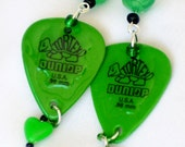 green guitar pick earrings, green carved rose,  green heart dangles and black bead accents long earrings apprx 3""