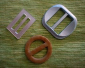 Three Vintage Plastic Belt Buckles