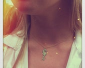 Tiny Pastel Green Seahorse Necklace on a Gold Chain.