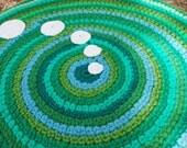 Green handmade circle rug