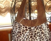 beautiful chocolate suede and giraffe fur handbag.