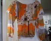 Vintage off shoulder abstract print with oversized ruffle ala 1970s