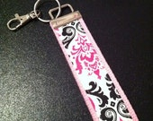 PInk and black damask key fob wristlet on pink cotton webbing with swivel lobster clasp