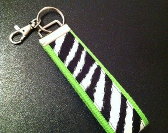 Zebra print key fob wristlet on lime green cotton webbing with swivel lobster clasp