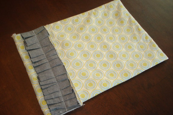 Blue green circles with grey pleated embellished diaper clutch
