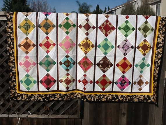 black, beige, gold and white quilt top