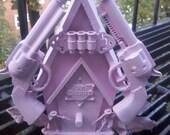pink cowboy birdhouse sculpture