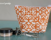 Small Makeup and Cosmetic Bag in Orange Pavlova Teak