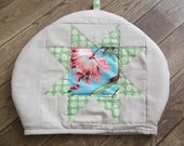 quilted patchwork tea cosy, patchwork star in spring colours.
