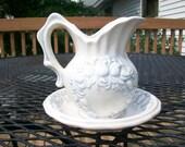 Ceramic creamer and saucer