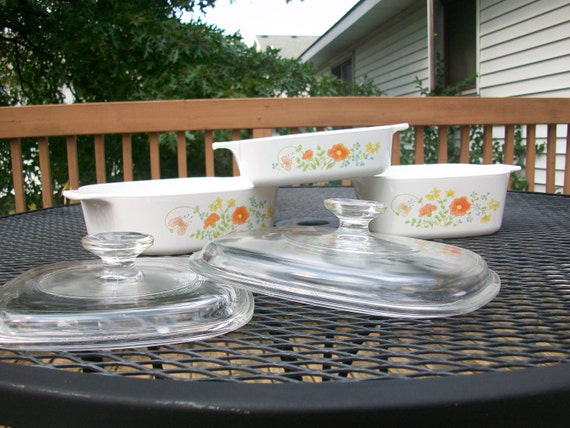 Vintage Corningware three piece casserole set with two Pyrex lids