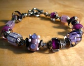 Bracelet with Purple Lampwork Beads, Swarovski Crystals, and Sterling Silver Beads