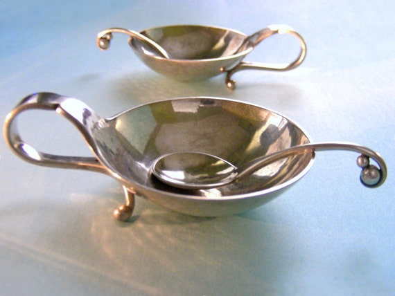 One pair of sterling silver Georg Jensen open salts and matching spoons, marked 110