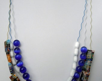 A Three Layer Crinkle Wire necklace with White, Blue, and Millefiori beads