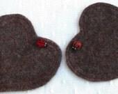The Love-bug mug rug.  Two hand-made alpaca felt, heart-shaped coasters with needle felted ladybirds.