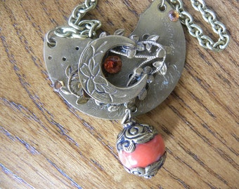 Pendant Steampunk Style with a Brass Necklace, Genuine Vintage Watch Part and Faceted Sapphires