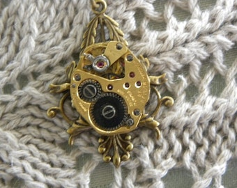 Pendant Steampunk Style with a Brass Necklace and a Genuine Vintage Watch Movement