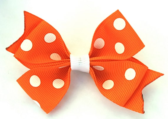 Orange bow with polka dots