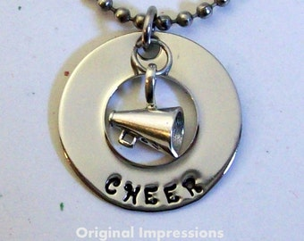 Cheerleader cheer leader megaphone pendant necklace of stainless steel with a sterling silver megaphone charm on a stainless steel chain.