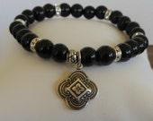 Black Onyx Beaded Bracelet with an Ornate Silver Clover Charm