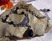 Victorian Inspired Silver Ornate Bib Style Necklace Adorned with Black Faceted Beads