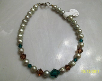 fresh water pearl bracelet with swarovski crystals in emerald green and chocolate