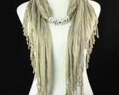 Scarf. Jewelry.  Necklace. Pendant. Silver. Beaded. Tan. Accessories.