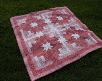 "Red/white quilt with white stars. 60"" x 60"""