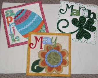 Monthly applique wall hangings